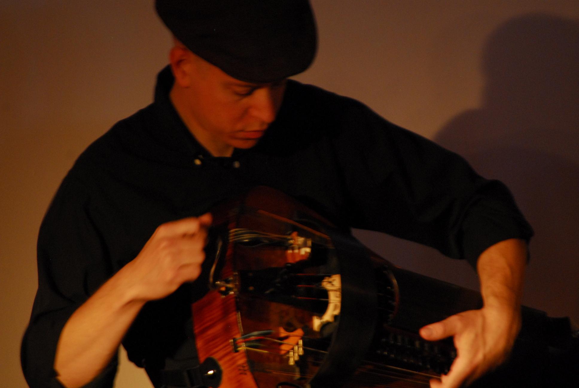 Ben Grossman playing a hurry gurdy