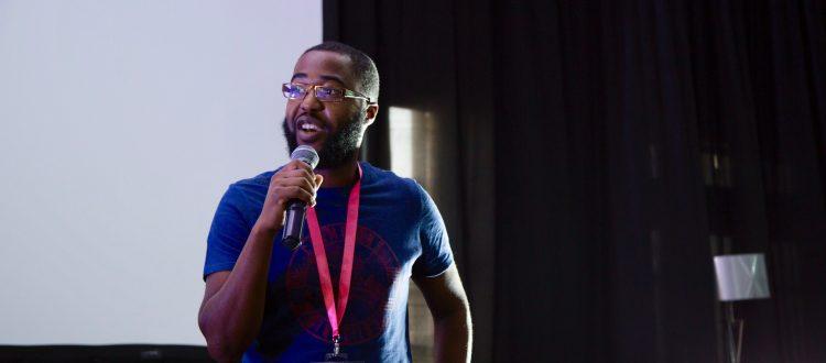 Farai Madzima presents on stage