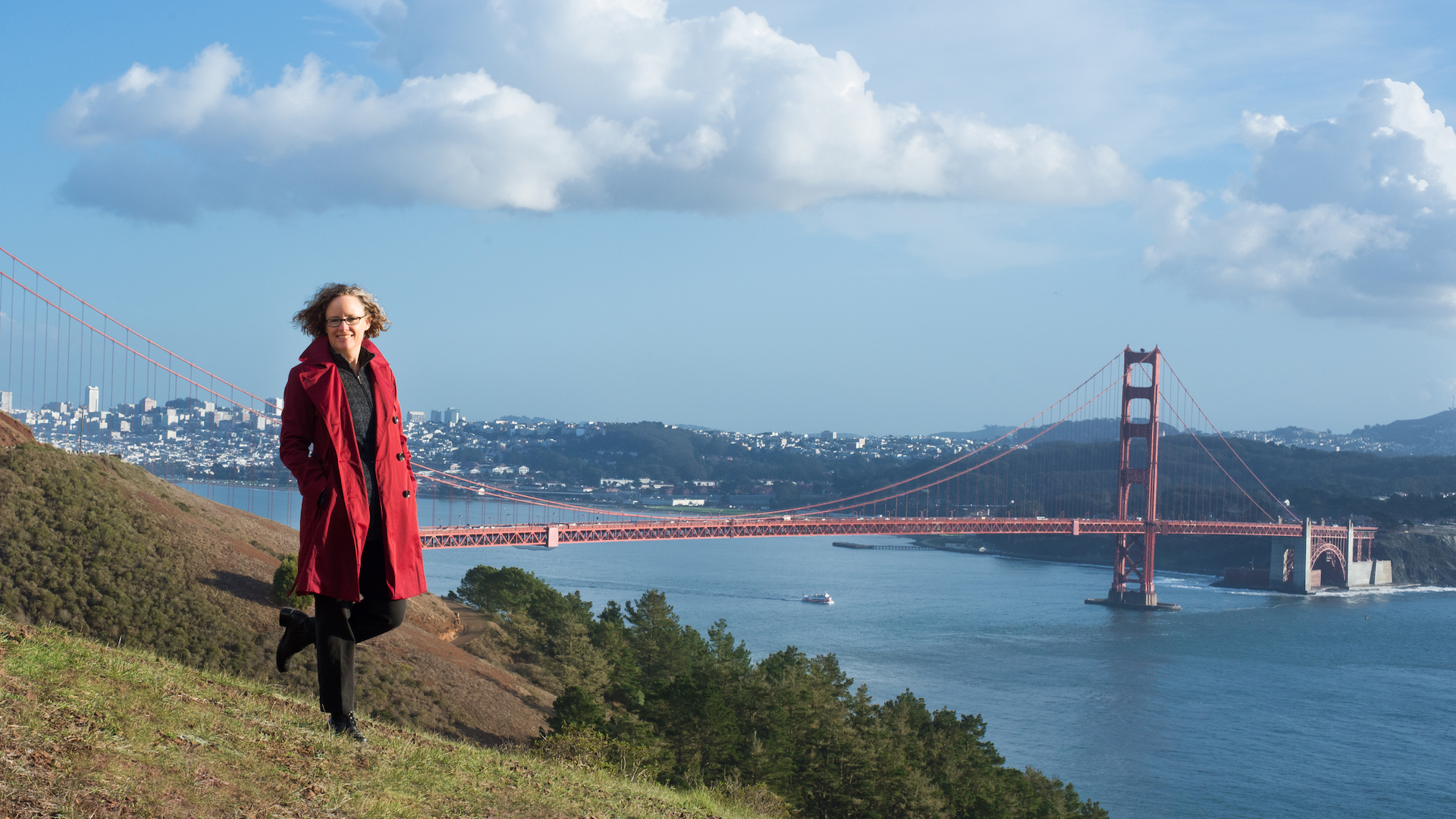 Indi Young stands on a hill overlooking the Golden Gate Bridge
