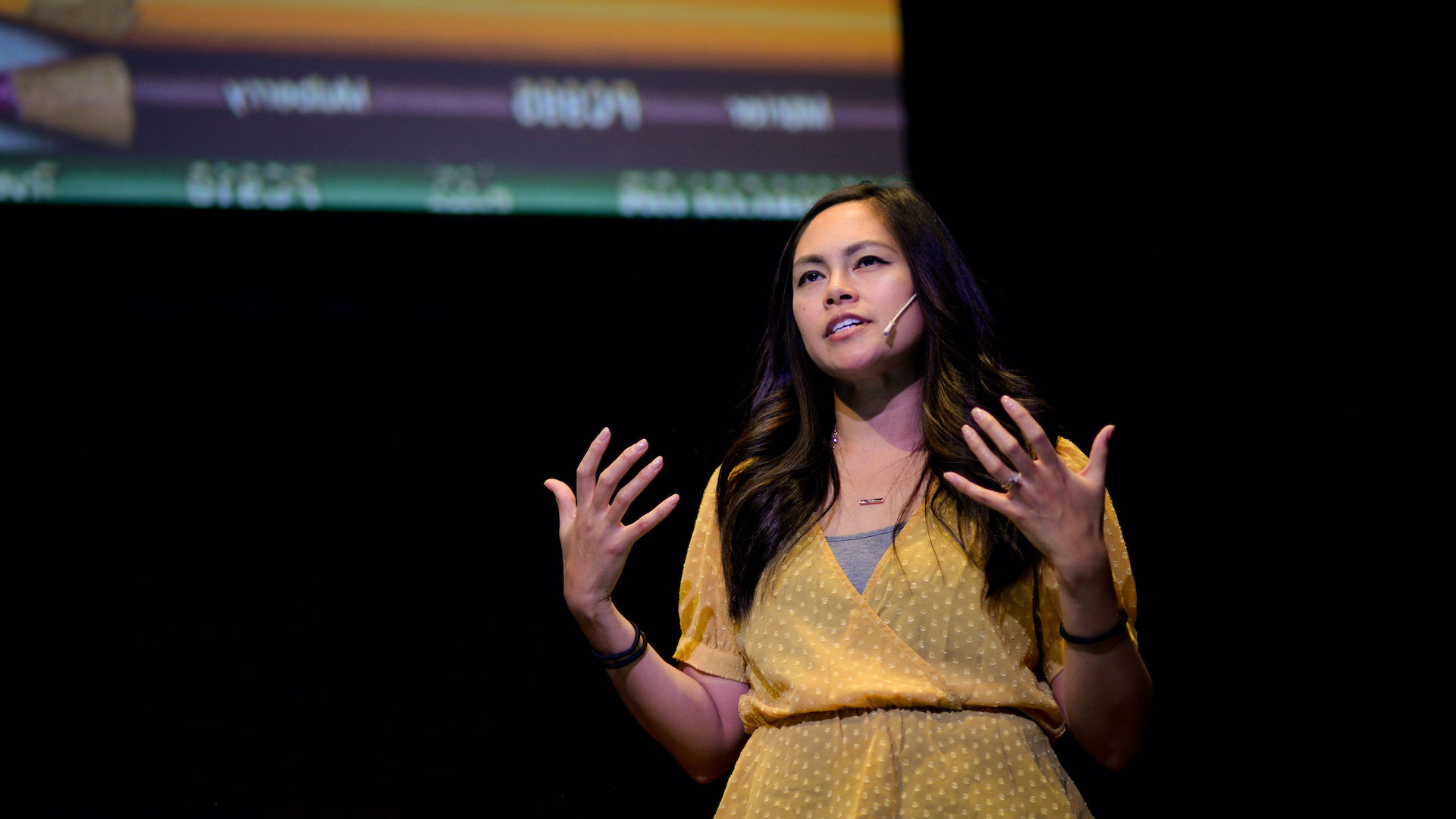 Yvonne Gando presenting on stage at Fluxible 2018