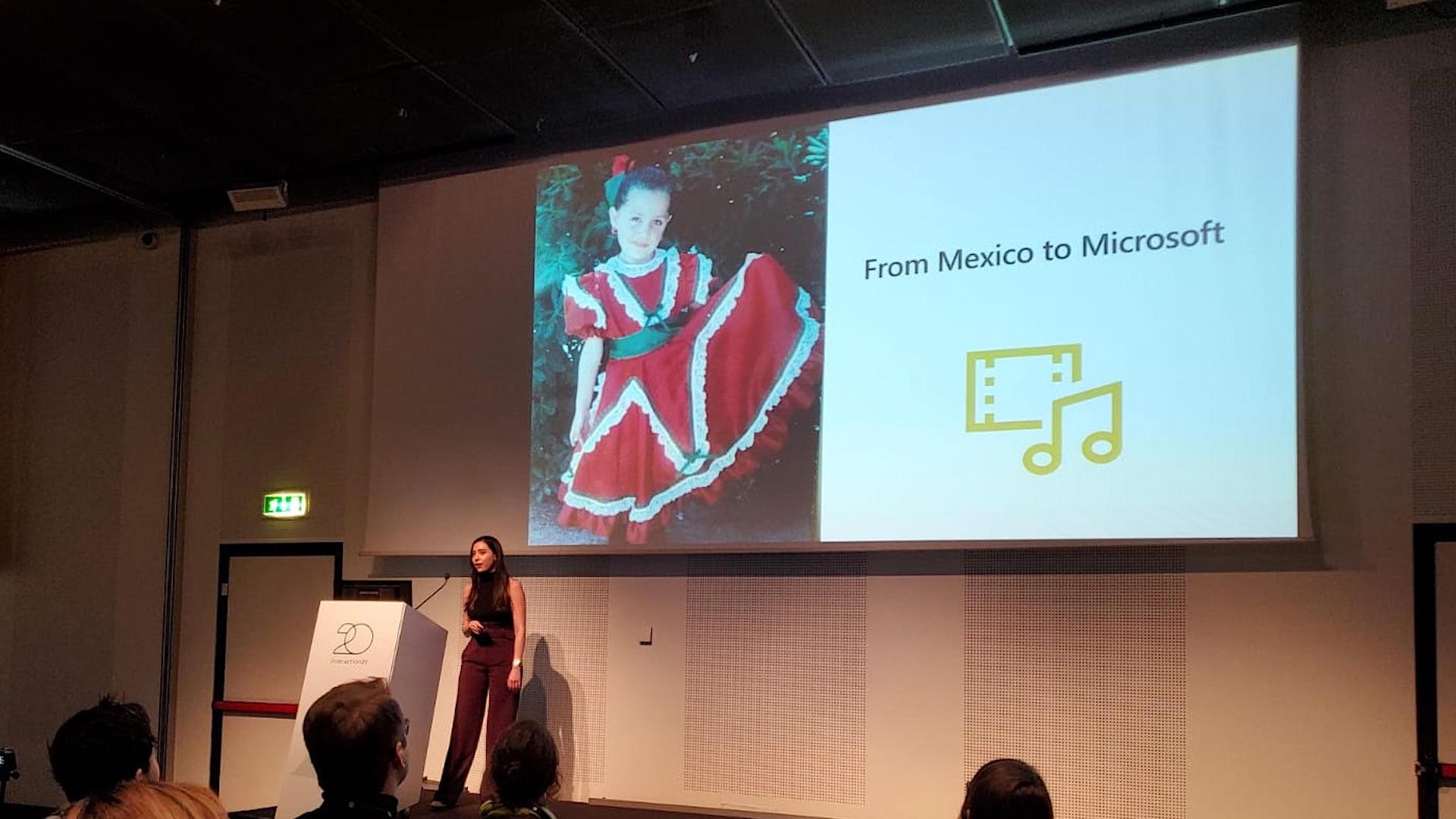 Ana Sofia Gonzalez presenting on a stage